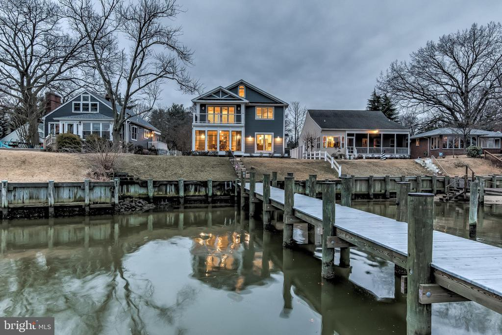 This impeccable custom-built three-bedroom, three bath home overlooking tranquil Back Creek was created for both casual waterfront living and gracious entertaining.  Thoughtfully remodeled in 2016, the residence presents a welcoming atmosphere with state-of-the-art systems and refined interior spaces providing the convenience and comfort of today's lifestyle, while the original design features retain a warm ambiance.  Every element of the approximately 2,200 square foot home is infused with the finest materials and high-end finishes from the rich bamboo floors throughout the main level, to design-inspired lighting and custom built-ins.  Notable features include the gourmet kitchen with granite countertops and spacious island with glass cooktop, professional grade appliances, and ample cabinetry for all storage needs, fireplaced family room that flows seamlessly to the window wrapped waterfront sunroom with its intoxicating views, and the master retreat with waterfront balcony, his and her closets, and en-suite luxury bath with glass-enclosed tile shower and granite double vanity.  The third level of the residence offers a water view bonus room with storage space, ideal for a recreation room or office. A true boater~s paradise, featuring a deep water ( 8+ MLW) 120 foot pier complete with boat slip, lighting and 100 amp electric service.