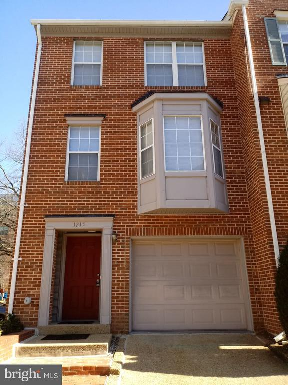 Large 2 bed room townhome with 2 1/2 bath. One block to Braddock Metro. Hardwood floors throughout living space with carpet in bedrooms. Open kitchen with appliances. Large bedrooms with jetted tub. Entry level has wood burning fireplace with access to gated court yard with patio. Garage + parking
