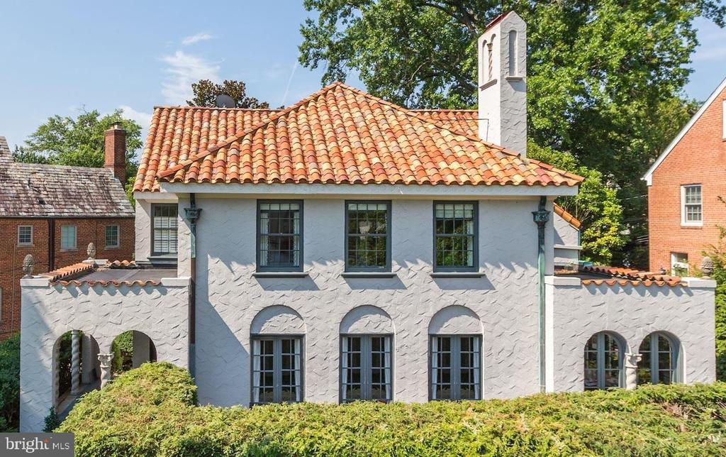 Gorgeous design-award worthy renovated Spanish Colonial prominently elevated on prime corner lot just north of Embassy Row and US Naval Observatory. Gleaming hardwoods, custom moldings, Chef's dream kitchen w/ Carrara marble, Thermador appliances, and custom cabinetry in inviting blue & gray tones. 5 BRs, 4.5 BAs include uber-luxe Master BA. Private wrap-around terraces w/ Hot Tub. 2-Car Garage, & more!