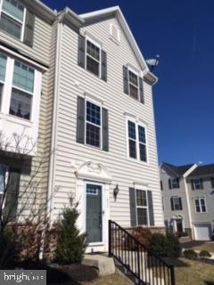 USDA 100% financing is available for this home!! A sought after end unit , Mozart model in Washington Square townhouse community located in award winning Owen J Roberts school district. This home boasts 3 bedrooms and 4 bathrooms, one on every floor! Enter on the 1st level to the family room with access to the over-sized 2 car garage (automatic openers included). There also is a powder room,  utility closet, and storage closet with built-ins. The main level has a spacious kitchen that includes black appliances ,a large island with seating, a pantry closet,and hardwood floor. The adjacent dining area has entrance to the deck. The large  deck is covered with  a Sunsetter Awning with LED lighting and remote control. A perfect spot for your family gatherings. Also on this level is the living room with a wall of built-ins, surround sound, ceiling fan and 9 ft ceilings and another  powder room. The upper level master bedroom has a large walk-in closet, a stunning tray ceiling, a ceiling fan and a master bath. The bath has a double bowl vanity and walk-in glass shower stall. Two more bedrooms, a hall bath and a laundry closet with included washer and dryer complete this level. A central vacuuming system, central air, security system, and customs blinds throughout are included!