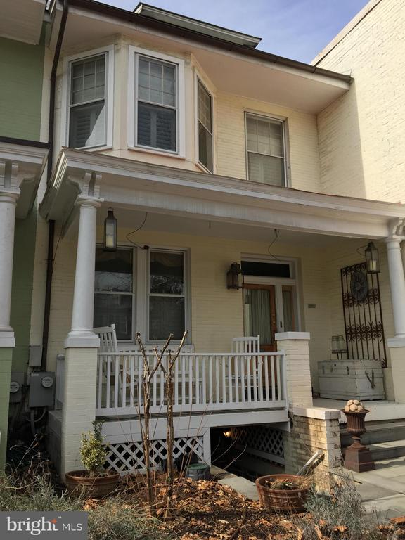 Great 3BR/1.5BA Georgetown TH in excellent location. Lovely front porch. Located just steps to Wisconsin Ave. Hall entry. Separate LR and DR. Powder room on main floor. Modern kitchen w stainless steel appliances. Enclosed rear porch with laundry overlooking wonderfully landscaped rear yard and garden. 2nd floor features 3 bedrooms and a modern bath. Dramatic master bedroom has exposed brick wall and ceiling beams, and a loft. 3rd bedroom currently used a large walk in closetListing Office