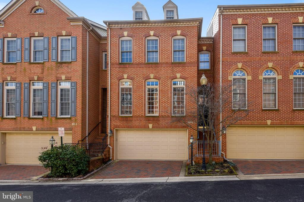 Rarely available townhome in Old Town Greens.      Charming Old Town lifestyle minutes to Reagan Airport, Amazon's HQ2, & Capitol Hill.  Walk to     Old Town restaurants and shops, new (to be built) Potomac Yard Metro stop, and the Mount Vernon/Potomac River trails.  This three level, two car garage townhome is in exquisite condition.  Large master with soaking tub, separate shower, his & her vanities and spacious walk in closet.  Two guest bedrooms, full bath and laundry facilities complete the 3rd level.  Kitchen updated with SS appliances.  Enjoy coffee or an evening cocktail on the raised deck or in your spacious fenced-in yard.  The main level is an entertainer's delight - whether a formal dinner party or casual evening with friends.  Lower level offers a cozy rec-room with fireplace and french doors opening to the lush garden patio.  Amenities include pool, playgrounds, tennis court and free rush hour shuttle service to metro.