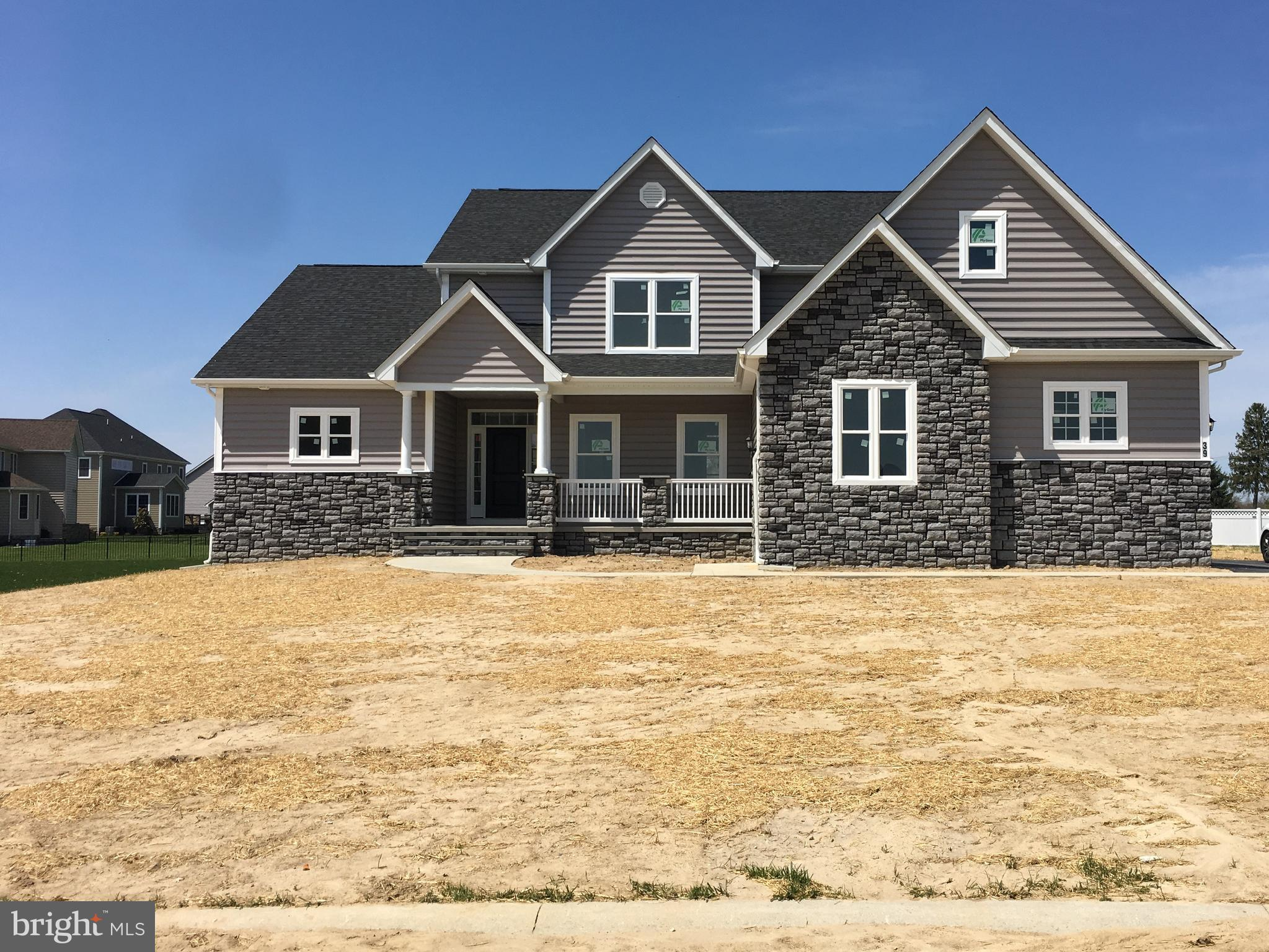 This Beautiful Waterfront New Construction has everything you can ask for with many opportunities. Ask about the extras. This home has a vesting foyer, den/library, dinning room with hardwood floors and open floor concept including the great room with fireplace, and kitchen. Gourmet Kitchen, granite counter tops, island, stainless steal appliances,plenty of storage. It features 4 bedrooms and 4 Full baths, with 2 master bedroom suites. Master Bed one on the main floor features Custom title walk-in shower and Whirl pool tub, double sinks, walk in closet. The second master bedroom is located upstairs with its own private bathroom, You will also find the additional 2 bedrooms and full bath upstairs, along with a cozy little loft area and large finished storage room. Ask about additional options for storage room. Hardwood floors in foyer, den/library and dinning room. Tile in all bathrooms, laundry room, kitchen and breakfast area. Check out all the additional features included in the listing. Builder is open to other building plans for this lot. If you like the lot but prefer a different style home please reach out to listing agent. Price change based on new plans.