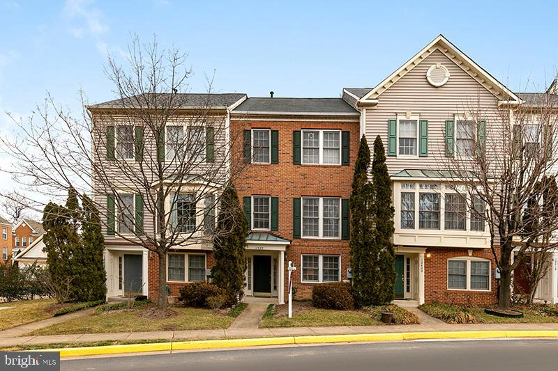 This meticulously maintained brick-front, 3 level, 2 car garage town home at Carr at Cedar Lakes in Fair Lakes, VA is move-in ready.  Lower level features entry way, foyer, rec room and rear load 2 car garage with storage closet.  Main level boasts beautiful solid maple hardwoods throughout, kitchen with breakfast bar, stainless steel appliances, backsplash, , pantry, oversized kitchen nook, large family room, deck.  Upper level features master suite, master bathroom with soaking tub and separate shower, plus two additional bedrooms and additional full bathroom.  Recent upgrades and renovations include deck, Quartz countertops in master bathroom and upstairs hall bathroom, lights, fixtures, hot water heater, A/C, gas furnace, whole house surge protector, solid maple hardwood floors, custom blinds, washer, carpet upstairs, dishwasher, refrigerator, and more.