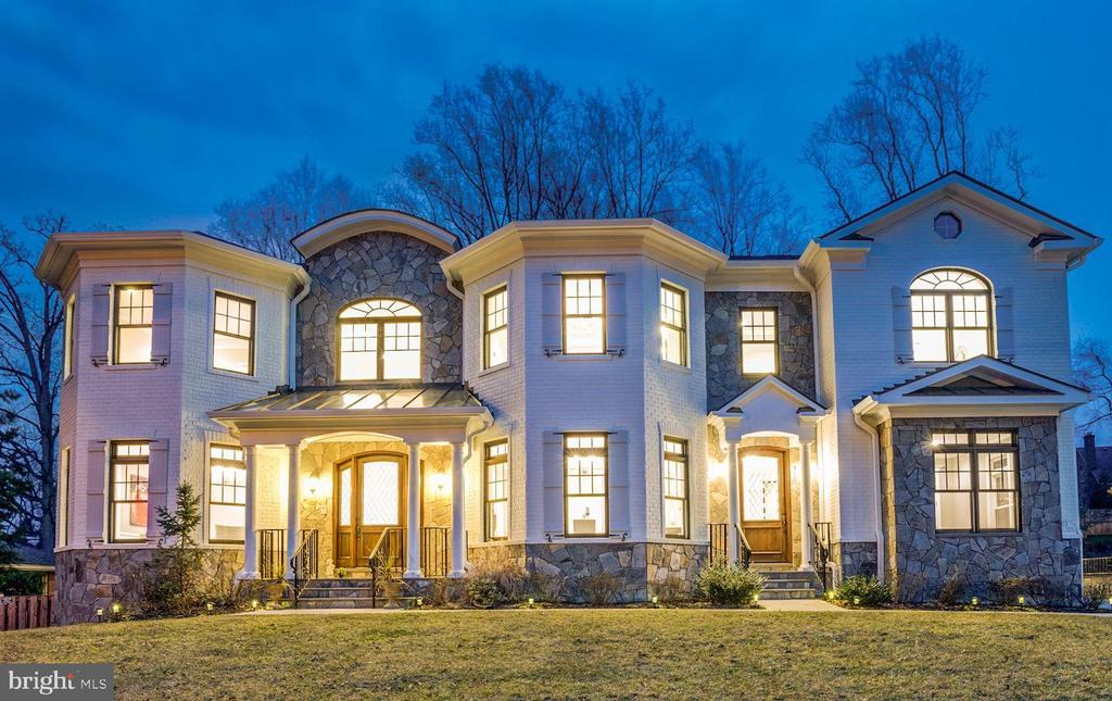 BEST VALUE IN MCLEAN! SUN-DRENCHED HIGH QUALITY LUXURIOUS CUSTOM HOME with SUPERB finishes! Stone/ brick elevation blended with Hardi-plank, Open and spacious floor plan with 10-ft ceiling on main level and 9-ft ceiling on upper and basement levels, Double grandiose staircases, Deluxe trim-work through-out the house, Beautiful hand-scraped hardwood floor, Elegant luxury chandelier lights everywhere, High-efficiency/ smart dual zone HVAC units (Carrier Infinity), Built-in 4-Zone Sound System, Built- in Security camera system (DVR), CertainTeed Landmark Pro Algae Resistant-AR roof shingles, Screened oversized Gutters.Main level hosting gorgeous formal living and dining room, Stunning gourmet kitchen which features Thermador professional grade appliances, built-in Espresso machine, large island with prep sink, Exotic granite counter-tops, and butler~s station w/wine racks, family room with COFFERED ceiling & beautiful gas fireplace, and an in-law suite/office suite with its own private entrance. Elegant Master-Suite with good-sized sitting area, double-sided fireplace, lighted tray ceilings, his and her custom closets, Glamorous master bathroom with separate soaking tub & rain shower.  Fully finished walk-out basement comes with Impressive Movie Theater, wet bar, spacious recreation room walking out to stone patio with built-in grill, perfect for entertainment. Basement also has 6th bedroom, full bath and a powder room for overnight guests. Oversized 2 car garage (3 car garage space) has lots of space for extra storage. Perfect location in Mclean school district, with short distance to Maryland, DC, Tysons and Amazon HQ2.