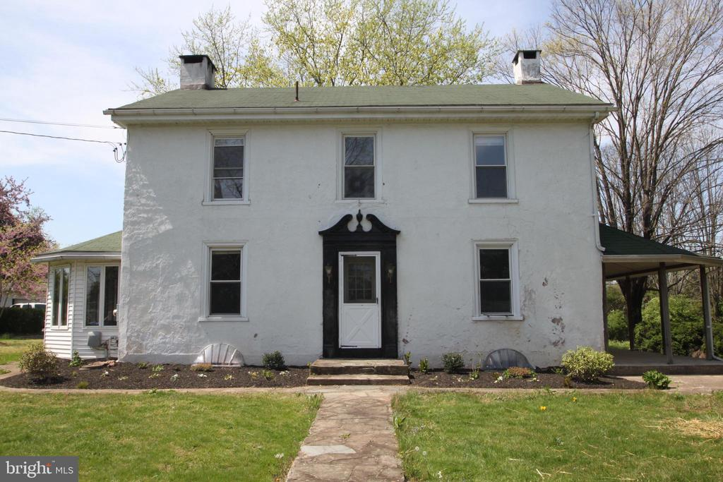 """Unique Opportunity, Investor Alert or for the Fixer Upper* This home sits on 9 + Acres of land that backs up to the NEW Schuylkill River Trail and offers a """"Clean and Green"""" school tax benefit through Chester County.  If you enjoy taking nature strolls, bike riding, equestrian activities, or enjoy scenic trail views, with low school taxes, this home is perfect for you! There are beautifully refinished original hardwood floors, deep window sills, spacious bedrooms, and plenty of room for storage. With a large covered back porch that wraps around the side of the home, and overlooking forest and fields, you have a great private place to relax with your morning or evening coffee or tea. As you enter into the foyer through the front door you have a large family room to your right, with a working fireplace. To your left is a formal living room/den area that opens up into the dining room, this room also has a fireplace but it has not been used. Close by is the sunroom that enters into a large eat-in kitchen area, equipped with a fireplace and the porch access nearby. The kitchen you will see has plenty of countertop space and cabinet storage with quartz counters, tile backsplash, wall oven and microwave, and Martha Stewart cabinets.  Tile flooring in the kitchen can be finished as you desire. Straight ahead, on the main floor,  is a full bathroom and your laundry room area that provides a second access to the back porch.  Upstairs there are 4 bedrooms all of ample size, each with their own closet. There is also a full bathroom on this floor that just needs to be finished to your preference. Continuing upstairs to a third floor there is a large partially finished attic area currently being used as a fifth bedroom; it also is great for additional storage.  The home has an upgraded 200-300 amp electrical panel, and a new Roof on the Main Home. A detached Large 4+ bay garage w/heat to the main garage offers workshop, boat, and additional car storage.  With 9+ acres, the proper"""