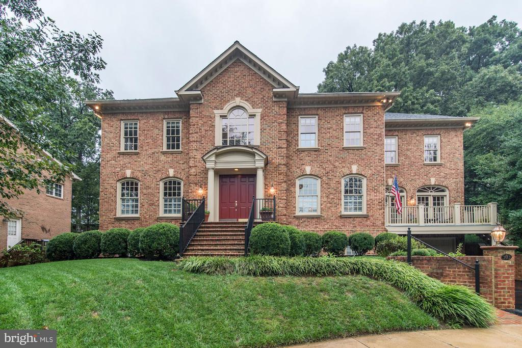 """Exceptional all brick home on quiet double cul de sac. Traditional exterior w double door entry opens to two-story marble foyer with exquisite trim details. Soaring ceilings & two-story space continue into the main level Master Suite w gas fireplace, a wall of windows lead out back to where a hot-tub was envisioned. Private hallway to arched window library, to left, of the foyer, has built-ins with file drawers, even a secret panel! Baby grand piano living room, to right, of foyer opens to a formal dining room w french doors to deck for cigars and brandy after meals. The large kitchen has 6 burner stove, indoor grill, double ovens, 2 'fridges, pantry & breakfast room open to the 2 story family room. It's brick woodburning fireplace has finish carpenter trim detail up to the ceiling and balances out the large built-ins with television & cabinets to hide receivers & other technology. A wet bar with ice machine, wine 'fridge & lots of cabinets is in the center of all these rooms. The open stairway overlooks the foyer and the family room. The hardwood hallway leads to five large upper-level bedrooms, one a suite, and two baths w the flexibility for a second Master suite or nanny suite with private bath on this level. The HVAC is zoned so that the upper level can be """"turned off"""" if not in use. The almost fully finished lower level has a nanny suite w sep. entrance, full bath and a bar that could be used as a kitchenette. The oversized 2 car garage opens into the tile floor mud-room and cedar lined closet. A step down opens up the HUGE rec room/exercise room w tall ceilings that allow for golf hitting net over-looking hole #7 at Pebble Beach, a 9' pool table, a ping pong table & a tv/game corner and a dart area. This level also boasts a large workshop, utility room, entertaining storage room, and a wine room. The entire home was designed by the builder for his own large family but is also suitable for an extended family. The combination of great flow for large scale elega"""
