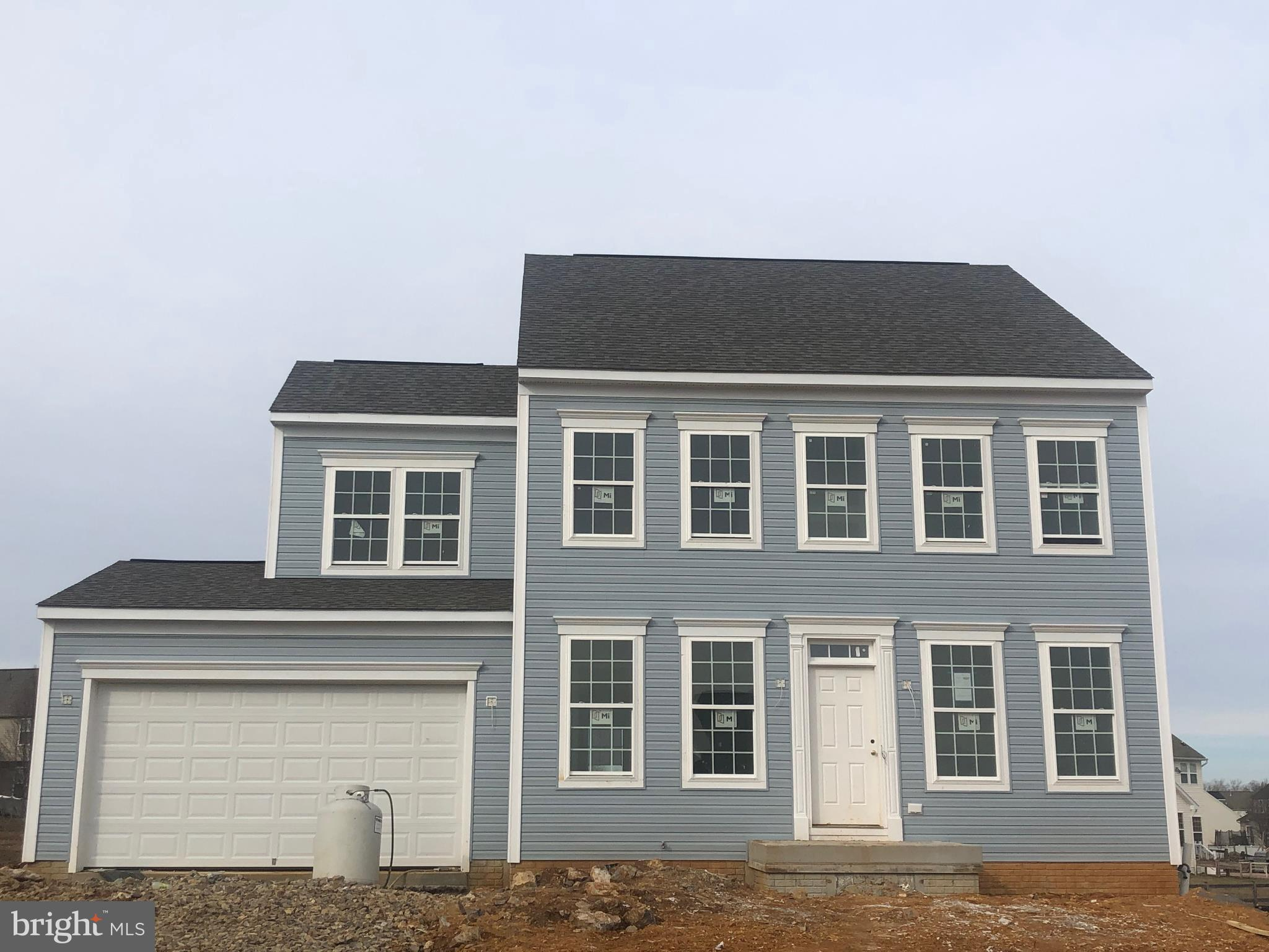 April Delivery!  Gorgeous 4 bedroom, 2 1/2 bath home w/4ft. rear ext. on all 3 levels, hardwoods on entire 1st floor, designer kitchen w/maple cabinets, granite, island & stainless appliances.  Family room w/gas fireplace.  Master suite w/dual walk-in closets, upstairs laundry.  Full unfinished walk-up basement w/3 piece rough in to expand later!!