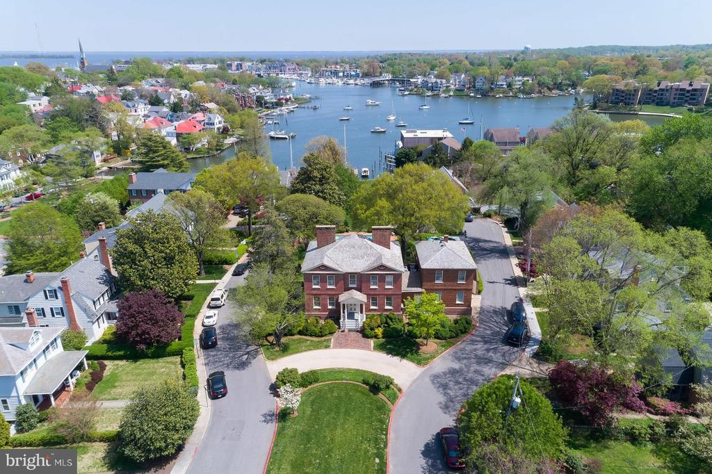 Acton Hall, the only historic house on it's original waterfront! Circa 1770 all brick, completely renovated/restored 1981. Fine vintage millwork & pine floors, 8FPs, interior window shutters, jib-doors to veranda overlooking Spa Creek. Large elegant rooms, gourmet Kit, marble Baths. Attached Carriage House w/1BR Apt. Beautiful landscaping, gardens, terraced lawns, pool, pool & boat houses & dock. Parking for total 11 cars including Garage, circular driveway & additional parking pad.