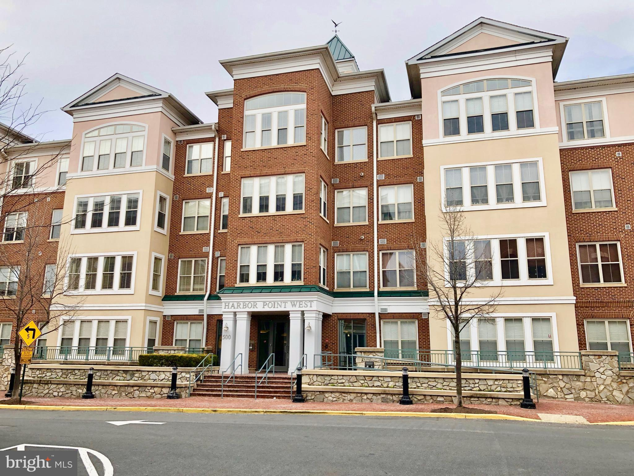 PROFESSIONAL PHOTOS COMING SOON * What A Great Price And Fantastic Location For This Super 2 Bedroom And 2 Bath Condo * Located In The Sought After Water Front Community Of Belmont Bay * Walk Out The Front Door And You Are A Block Away From The Waterfront Marina * This Unit Features A Light Filled Sunroom And Large Living Room * Kitchen Features Corian Counter Tops And Gas Cooking * Separate Formal Dining Area * Large Master Bedroom With Walk~In Closet * Master Bath With Custom Tile Double Shower And Ceramic Tile Flooring * This Unit Includes Private Storage Unit Right Outside The Front Door And 1 Garage Parking Space * Fitness Center Located Inside The Building * Don't Miss Out On The Beautiful Sunsets While Strolling The The Water Front Enjoying The Walking Paths And Community Gazebos * Walking Distance To The Virginia Rail Express Train Station * Minutes To Shopping And Major Commuter Routes Including Route 1 And Interstate 95 * A True 10+!