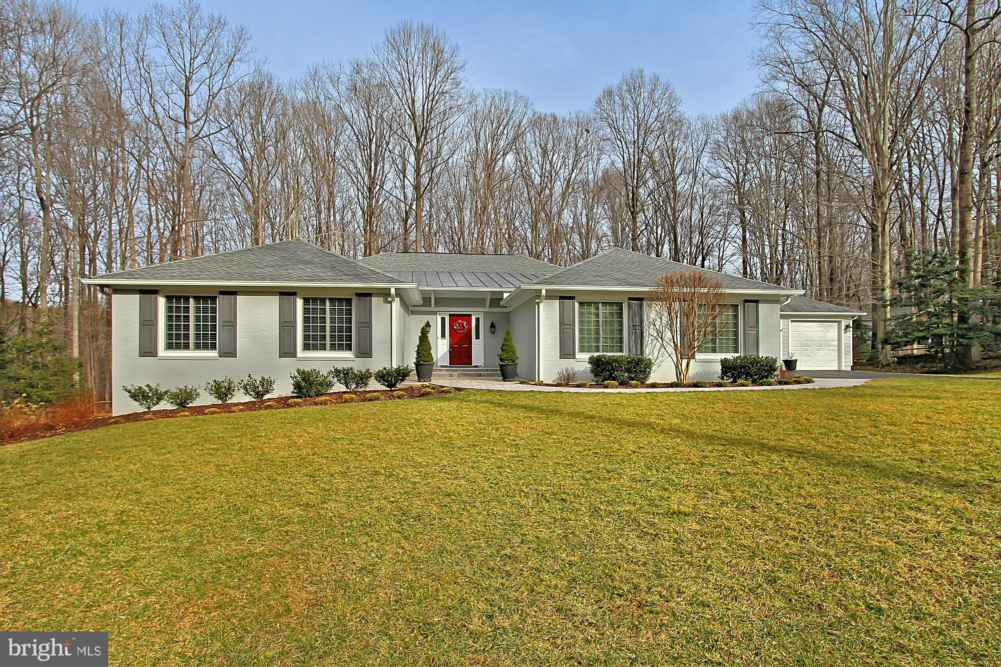 One level living at its finest!  Exquisite, completely remodeled, one-of-a-kind gem in popular Ardmore Woods.  This 4 BR, 3.5 BA transitional style home delivers 5,400+ sq. ft. of interior living space and a premium 1.16 acre wooded lot backing to parkland for ultimate privacy.  Stately brick exterior, garage parking for 3 cars, and an open floor plan!  Wide-plank cherry hardwood floors, two fireplaces, custom built-ins, high ceilings, and an abundance of windows!  Custom designed gourmet kitchen w/ Subzero refrigerator, Jennaire down-draft cooktop, and Wolf double ovens and warming drawer.  Gracious main level master suite w/ unbelievable custom walk-in closet and master bathroom w/ double sink vanity and over-sized frameless glass shower w/ built-in bench.  Cheery Sunroom w/ pastoral views!  Lower level rec room w/ walk-out features fireplace and wet bar.   LL Fourth bedroom and full bath are perfect guest quarters!  Separate workshop w/ workbench / cabinets and storage space!  Maintenance-free Fiberon deck w/ slate patio and expert landscaping!   Generac whole house generator!