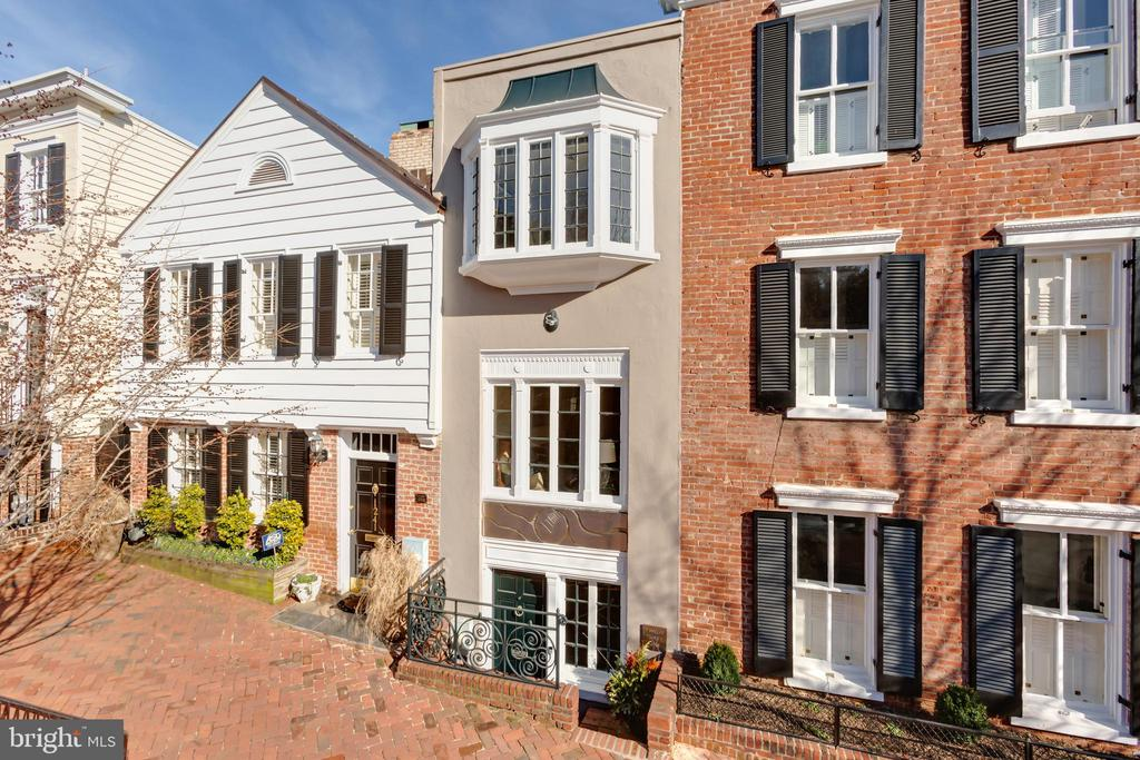 This turn-key townhouse seamlessly unites historic appeal and comfortable elegance throughout all three finished levels. The front exterior provides a modern facade with custom artistic metalwork while the interior is filled with Georgetown charm. Ample entertaining space, a cozy sunroom and desirable period details define the property. Notable features include hardwood floors, two fireplaces, tall bay windows and custom built-ins. The sun-filled top level provides walls of windows, multiple skylights and a large master dressing room. The walk-out kitchen leads to the private garden and storage shed. A sleek elevator and brand new heating and cooling systems complete the offering. Ideally located in Georgetown's East Village, 1239 30th Street NW is situated just steps to M Street's numerous shopping and dining venues.