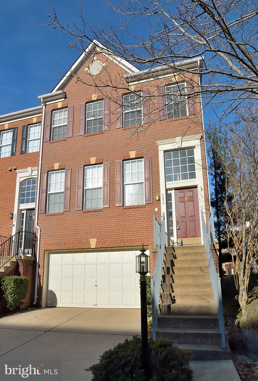 Major price improvement! Open Sun 3/24, 2-4:00.Spacious and sparkling end unit 2-car garage townhome. 3-level bump out. Huge kitchen features new stainless appliances, gas fireplace, hardwood, center island, pantry, ceiling fan & 2 seating areas. 3-lvl bump out give extra 10X11 space. Slider to deck. Huge owner's bedroom w vaulted ceiling, 2 walk-in closets. Light bright bath w soaking tub, separate shower, double vanity. Convenient washer & dryer on bedroom lvl. 2 other bedrooms & full bath complete upper lvl. Lower level family room w gas fireplace, half bath, oversized storage closet. Bump out gives that extra space. Sliders to patio & fenced yard. Everybody loves Kingstowne with its 2 pools, 2 fitness centers, trails, town center, restaurants, movie theater, summer outdoor market & concerts.