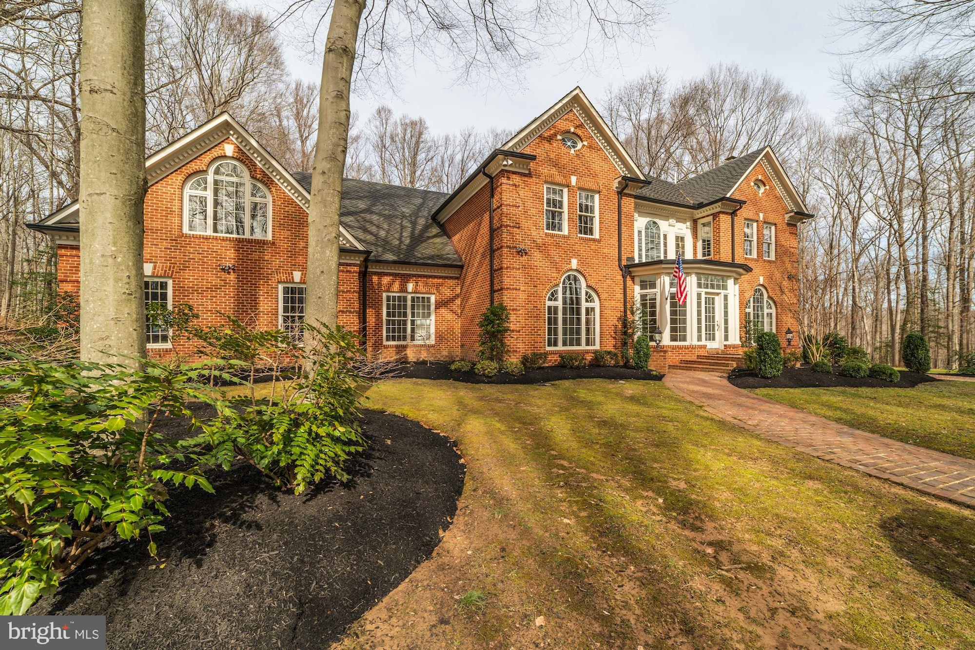 Stunning, custom-built home on 5 private partially wooded acres in historic Fairfax Station. Exterior features include a heated swimming pool and spa, professionally landscaped yard and gardens, and an expansive deck and brick patio, all of which provide a fantastic backdrop for relaxing and entertaining.  Interior features include hardwood inlay paneling and floors, distinctive marbling, three fireplaces, and spacious bedrooms with loads of closet space,  The lower-level, which has direct access to the pool, hosts a pool changing room, a recreation room, fitness room, and a en-suite guest quarters. Truly a remarkable home that will not disappoint.