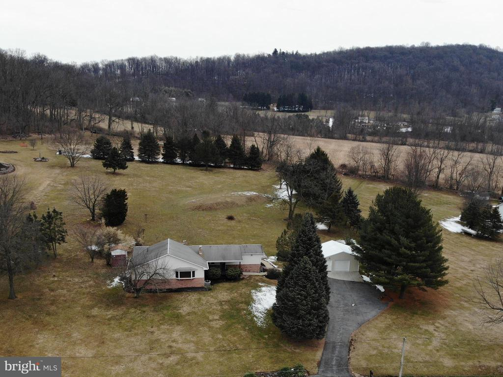 Unique opportunity to own 2.5 acres in Cocalico School District.  1 floor living features over 1,900 sq ft.   40 handle kitchen with island & eat in area.  First floor laundry.  Full basement with bilco doors into shop area.  Newer HVAC, hot water heater, septic.  This home has a lot to offer.  Bring your imagination and see how you can make this property home!  Due to the mobile home, property will need to be a cash buyer or in house bank financing.
