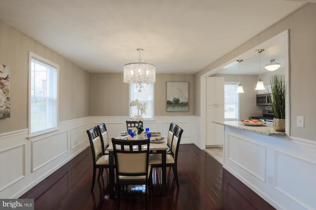 The main level hard wood floors could very well be the most beautiful you have ever seen!  Fully renovated brick colonial in Ashburton with 3 Bedrooms 1.5 Baths.  Dual entry bathroom off master.  Recessed lighting on main.  Granite counter tops,  finished basement.  Close to Hanlon Park, Lake Ashburton, Maryland Zoo, and Sinai hospital.  WILL CONSIDER RENT TO OWN