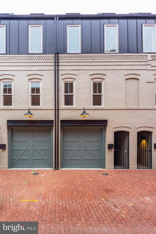 Urgent Update!  1319 Linden Court is now SOLD but 1313, 1315, and 1317 are still available.Linden Court is the next Blagden Alley/Naylor Court. This DC Alley is on the verge of an extraordinary transformation with several successful developers conducting redevelopment studies for both commercial and residential mixed-use projects. The Prestige and Desirability of mixed-use alleyways is Increasing in desirability by the day due to its limited inventory. This exclusive style of living has just grown as a result of these four new construction townhouses Which are the first of its kind since Naylor Court 5 years ago. These 4 modern alley mews pay homage to the history of robust alley dwelling with an elevated architectural restoration and exceptional interior design. The pride in maintaining the original historic facade while adding a third level that enhances the desirability of future home buyers is simply a match to be featured in Architectural Digest. This three story plus loft masterpiece will delight visitors looking for something amazing. The welcoming ground level is enchanting and welcoming as a multipurpose area. The wall of glass allows the living space to becomes one with the outside private courtyard. Whether serving as an office, family room or master suite, the entry level is a delightful first impression for visitors. The main level is flooded with natural light throughout the open floor plan. The custom Snaidero Kitchen Cabinetry, Miele appliances and Juliette balcony sets the tone for many more elegant design features to come. The vaulted ceiling with skylights and dramatic lighting on the upper level is rivaled only by the en-suite bath with floor to ceiling marble. This master has direct rooftop terrace access complete with a party loft and set bar. All and all, this 3BR, 3BA, 3LVL  plus loft townhouse has wow-factors at every turn to include a custom carriage-style wood garage door for one car parking. Please tour Blagden Alley and Naylor Court Alley before and after touring this amazing new construction designed build by Monarch Design DC in Linden Court. This is the life experience you have been waiting for...so act fast while still available.            1313 Linden = $999,000.   1315 Linden = $1,024,000.   1317 Linden = $1,024,000.  The model can be purchased with all the furniture for an additional fee.