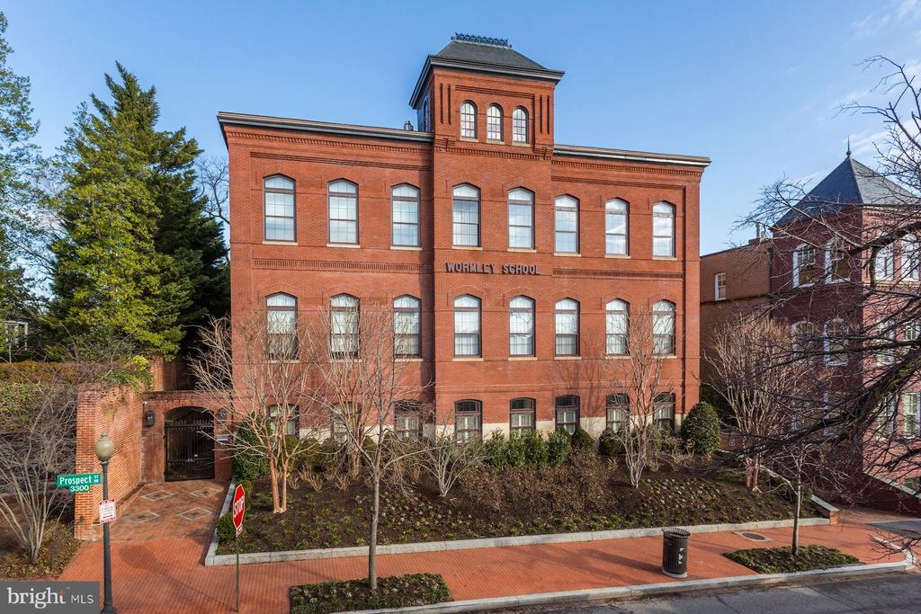 Just a stones throw away from M Street in Georgetown~s West Village sits The Wormley School, a historic landmark schoolhouse which dates to 1885.  Behind a storied red brick facade on the School~s first floor sits an immaculately redesigned 2 Bedroom, 2.5 Bathroom residence.  2,700 light-filled square feet are complimented by timeless finishes including a La Cornue Range, white marble and rustic walnut countertops, custom paneled SubZero refrigerator and freezer, Tom Dixon light fixtures, steam showers, soaking tubs, and two gas fireplaces.  Through the kitchen and off the residences sunroom is an expansive outdoor terrace with a gas firepit and grassy dog run.  Underneath the old elementary school which was named for James Wormley, a prominent African-American Businessman and Social Advocate, are one storage unit and two assigned parking spaces.  History meets sublimity in Georgetowns West Village.