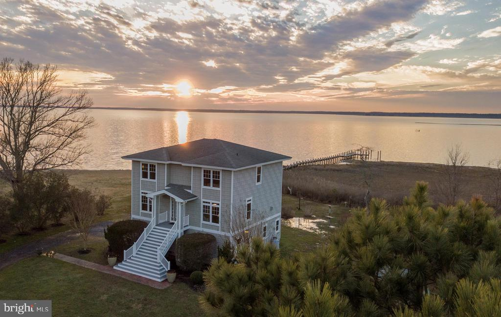 This exceptional bayfront home is situated with its own private sandy beach, pier and boat dock.   Overlooking Newport Bay and graced with spectacular views and sunsets, the setting is a nature lover's paradise.  Bald Eagles and Ospreys are seen regularly and in the spring, you are greeted with naturalized daffodils along the driveway.  The home itself is quality construction, built in 2004 by White Creek Homes and features tinted windows throughout, quality Cedar Impression vinyl siding, a gas fireplace, Geo-thermal heating, two lovely porches and a three car garage.  Located just three minutes to Assateague Island and three championship golf courses, come make this your dream home!