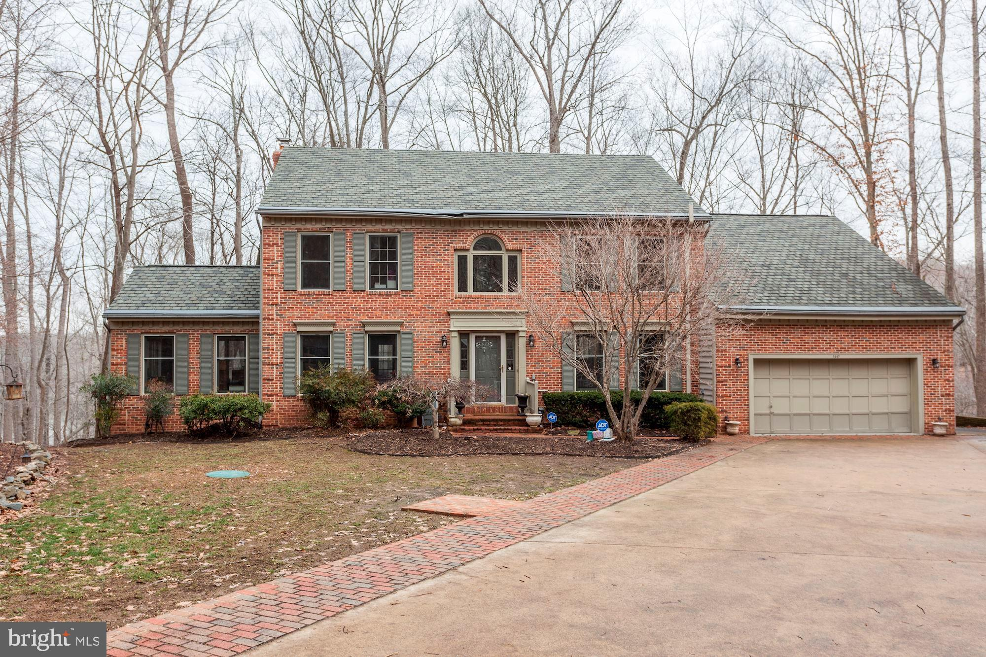 STUNNING WATERFRONT WITH DOCK WITH 270 DEGREE VIEW OF THE OCCOQUAN WITH AMAZING WATER VIEWS FROM MOST ROOMS ON OVER 3 1/2 ACRES***YOU ARE ALMOST ON YOUR OWN PENINSULA!!!****REMODELED TOP OF THE LINE KITCHEN, MOCHA HARDWOODS, SKYLIGHTS IN REMODELED MASTER BATH WITH TRAVERTINE -***ONE OF THE MOST BEAUTIFUL NEW GOURMET KITCHENS YOU WILL SEE WITH HUGE CENTER ISLAND, TO P OF THE LINE CABINETS, GRANITE, CABINETS, HUGE WALK-IN PANTRY***AMAZING HAND SCRAPED HARDWOODS THROUGHOUT MOST OF MAIN LEVEL***2 FIREPLACES***REMODELED BATHROOMS INCLUDING TRAVERTINE, STEP UP TUB, SKYLIGHTS, NEW SHOWER GLASS, DOUBLE VANITY (YOU HAVE TO SEE THIS HOME)**ENORMOUS MASTER CLOSET, PATIO, LARGE DECK & DRAMATIC SETTING***2 FIREPLACES***GREAT SCHOOLS INCLUDING COLGAN HIGH SCHOOL**4 CAR GARAGE PARKING
