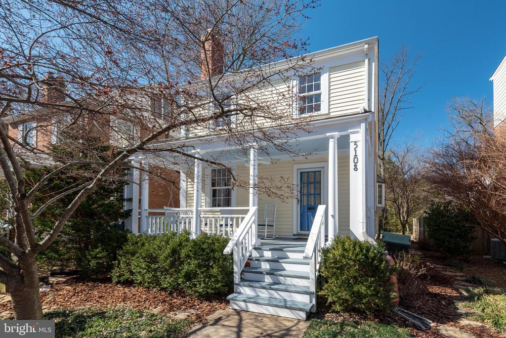 Open Houses Sat & Sun March 2 & 3 from 2-4pm.  A delightful Little Free Library and charming front porch complete with porch swing (conveys with sale) greet you at 5108 44th Street, NW in AU Park. Wonderful and close-by amenities to explore in this desirable neighborhood & home, including just a few (2) short blocks to Metro and bus lines on Wisconsin Ave (1 block) to the best of DC, plus even more pleasant surprises once inside the home. Elegant and charming at once, a formal living room welcomes you, with a wood-burning fireplace, separate dining room and open concept to the expanded kitchen/family room, part of a two-story addition. Also find hardwood floors throughout this home, including pine floors on finished 3rd level. Enjoy the 2-story addition (2002) that added a beautiful & timeless chef's kitchen with beautiful granite counters and cherry cabinets. A granite breakfast bar/island and adjoining family room create a convenient great-room you will enjoy year round. From this kitchen/family room addition, access the rear patio and yard through sliding doors, with steps to the lovely landscaped yard and patio with decorative fencing and pergola (added 2016). The yard is an environmentally friendly, low maintenance yard with multiple specimen trees including Cherry tree, 2 Maple trees, Serviceberry tree, 3 Crape Myrtles, and a Hinoki Cypress.  The 2002 addition also included a main level powder room renovation and the creation of an ~office~ space across from the convenient large pantry. Once upstairs, you~ll notice the smartly expanded master bedroom and beautiful master bath (part of the addition), a hall bath (bath #2) and another generously sized bedroom #2.  Bedroom #3 is currently used as an office and has a lovely walk up stair-case to a finished attic, used by these owners as bedroom #3.  Be careful, your household members may fight over who gets to call this room their own, as the large dormers and fantastic sunlight will be sure to melt the blues away