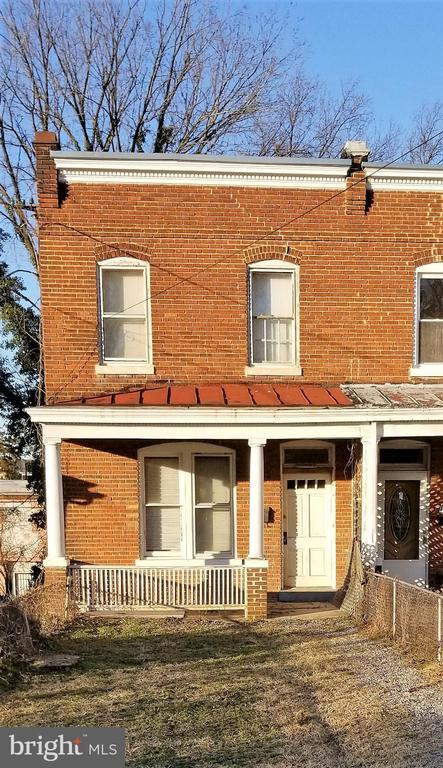 1917 rowhouse close to Metro (4 blocks) and central Brookland with ~good bones~: 9.5 foot first-floor ceilings; plentiful light from windows on 3 sides; full-height walk-out basement; EPDM (rubber) roof; 2 off-street parking spaces when rear yard is re-graded; first-floor half-bath. This house presents the opportunity to own in a popular community, and with ~sweat equity~ and modest investment, to profit from rising home values.  Part financing can be available to a qualified purchaser. Sold strictly as-is, needs complete rehab.