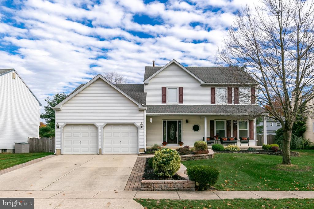 """Welcome to desirable Timbercrest Development in prestigious Mount Laurel. This home has been meticulously maintained by the original owner. It has wonderful curb appeal with an inviting full front porch and lovely front door with matching sidelites. The owner has upgraded every room throughout the home. Enter the home with a spacious tile foyer, leading into an upgraded kitchen with 42"""" cabinets, granite counter tops, tile back splash, large tile flooring, and a custom pantry. This open floor plan flows into the family room with a stone hearth gas fireplace. A modern living and dining room sit side by side. A large mud/laundry room with full wall built-in shelving and upgraded powder room complete the first floor. The second level has an upgraded tiled master bathroom and main bathroom. The four spacious bedrooms are freshly painted with wood flooring. If you are looking for a home with the perfect entertainment spot, then your search is over. The BREATHTAKING finished basement is a MUST SEE! It has a custom wet bar with a granite countertop, recessed LED lighting throughout, numerous six panel doors, hidden storage areas, slider windows, pottery barn colors, perfectly detailed finishes and much more. A full backyard patio invites you for year-round entertainment including a fenced yard. Other fine features include newer roof (8 years), newer hot water heater (3 years), newer heater (5 years), newer air conditioner (5 years), underground sprinkler system, and 2 garage door openers. Easy access to Rt 295, Rt 38, Philadelphia and the turnpike. Located near shopping, dining and in Mount Laurel's great school system."""
