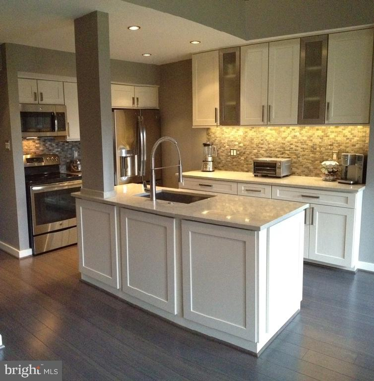 1/2 Block Ballston Metro.  1BR+DEN+2BA. Fully Renovated 2-Level Penthouse Loft. Triple-Arch Balcony.  Wood-Burning Fireplace.  2 Skylights.  Gray Bamboo Hardwood Floors.  Bedroom Has Large Walk-In Closet + Reach-In Closet + Linen Closet.  Washer/Dryer. New HVAC Sept 2018. Low Condo Fee. 1-Assigned Parking Space. Murphy Table and Den Shelves Convey. Owner is licensed real estate agent.