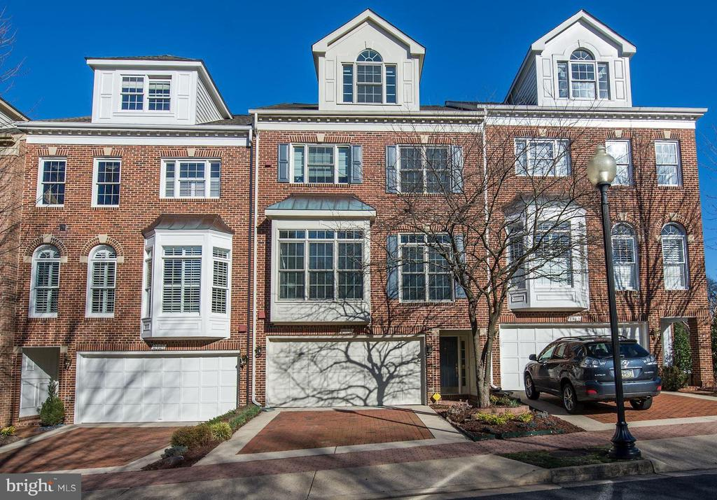 Open Sun March 3 1-4 PM.  Amazing 3 BR/5 BA townhome is just a few blocks from Rosslyn Metro and slightly over a mile to Georgetown.  This updated townhouse incorporates modern amenities with a fantastic location.  It defines move-in ready!  Many, many updates including all new windows throughout the home (including cathedral windows), bathroom vanities, recessed lighting, hot water heater, carpet in top/bottom level and paint.  The master bath was extensively remodeled in 2014 along with hardwood floors for the steps and main bedroom level.  The living room boasts high ceilings with 3 cathedral windows that let in copious morning sunlight.  You can even head outside to the deck to relax or barbecue.  The adjoining dining room sits above the living room and it too is bathed in sunlight.  The kitchen has an updated backsplash, granite countertops and stainless steel appliances.  It is large enough to accommodate a sitting area or a more informal dining area.  Upstairs, the master bedroom has a cathedral ceiling and a gas fireplace with sitting area including a flat screen TV.  The master bath has been updated with a spacious tile shower stall and it also incorporates a washer/dryer in the closet.  The jacuzzi tub has a built-in hot water heater and circulator to keep the water warm.  All bedrooms in the home have their own baths.  In the lower level family room, there is an another gas fireplace, an additional laundry closet with hookups, and a half bath.  From there, you can walk right out to the beautiful, private flagstone patio.  Storage is abundant in this fantastic home - in the two car garage, the master BR, the hallways, and the eaves off the top floor BR.   Across the street is a park.  Restaurants, shopping, and entertainment in the Rosslyn-Ballston corridor are 5 minutes away.  Indoor space, a touch of luxury, and a wonderful setting - what more could you ask for?
