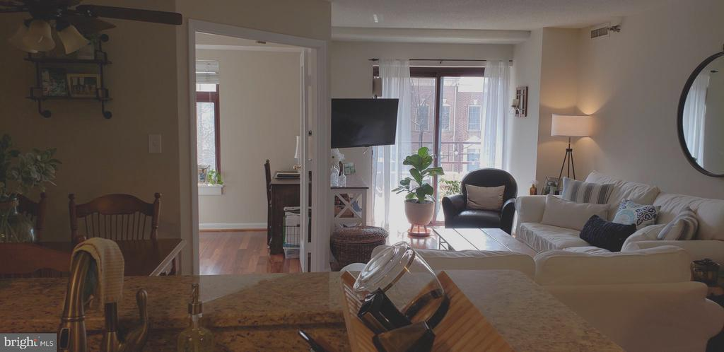1BR + Den & Balcony in immaculate condition. Clarendon Metro station is 0.6 miles away.  In unit stacked W/D. Gourmet kitchen with granite counters, stainless steel appliances, tray ceiling, built in microwave, refrigerator with ice maker and tile floor. Gorgeous hardwood cherry floors throughout. Move-In fee is non-refundable. $400 Mon - Fri. $500 on Saturday and Sunday. 12 month lease minimum.