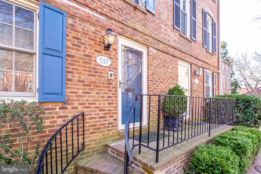 Stunning brick townhouse situated in a prime location in Old Town.  Exceptionally bright and meticulously maintained, this four-story townhouse boasts 3 bedrooms, 3.5 baths. Features include a gourmet kitchen, hardwood floors throughout, 2 fireplaces, a private backyard patio, and off-street parking. Plenty of room to entertain in the bright living or the beamed family room that adjoins the sparkling kitchen. Located in a courtyard surrounded by trees, you can enjoy the privacy of this home while also being steps away from all of the restaurants and retail that Old Town has to offer!