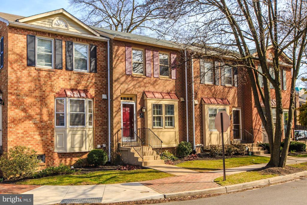 **RARELY AVAILABLE** 3 level fee simple townhome in the heart of Ballston!  **79 Walk-Score**Metro & Ballston Quarter just blocks away** Updated kitchen boasts custom maple cabinets, stainless KitchenAid appliances, black granite countertops, plus a separate coffee bar.  The living spaces are light and bright with hardwoods floors throughout.  Don't miss a newly installed private backyard patio; the perfect place to enjoy your favorite spring cocktail!  2 bedrooms upstairs; the master has two closets, one of which is a huge walk-in leading to an updated bath.  Need more space? Check out the basement which has a full bath, spacious rec room/3rd bedroom, plus a bonus room; a great office or potential guest quarters.  New Trane HVAC and LG W/D!  Assigned parking spot #2, with 14 community visitor spots. **OFFERS DUE 3/5 at 5pm**