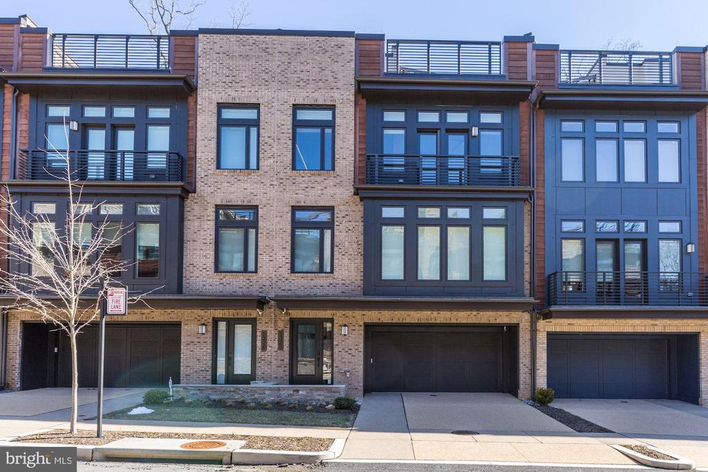 Spectacular, immaculate, distinctive, elevator townhome in EYA's latest development, Grosvenor Heights. This mint condition Harrison model has 3,102 SF and a 1,387 SF roof terrace.  Located in an ultra-convenient neighborhood, one is within one mile of the Grosvenor Metro on the Red Line and just moments away from Rts. 495 and 270.  With high ceilings, bright, open spaces, modern amenities, upgraded Lutron shades, upgraded Lutron lighting, California Closets and more, you will love this unit!