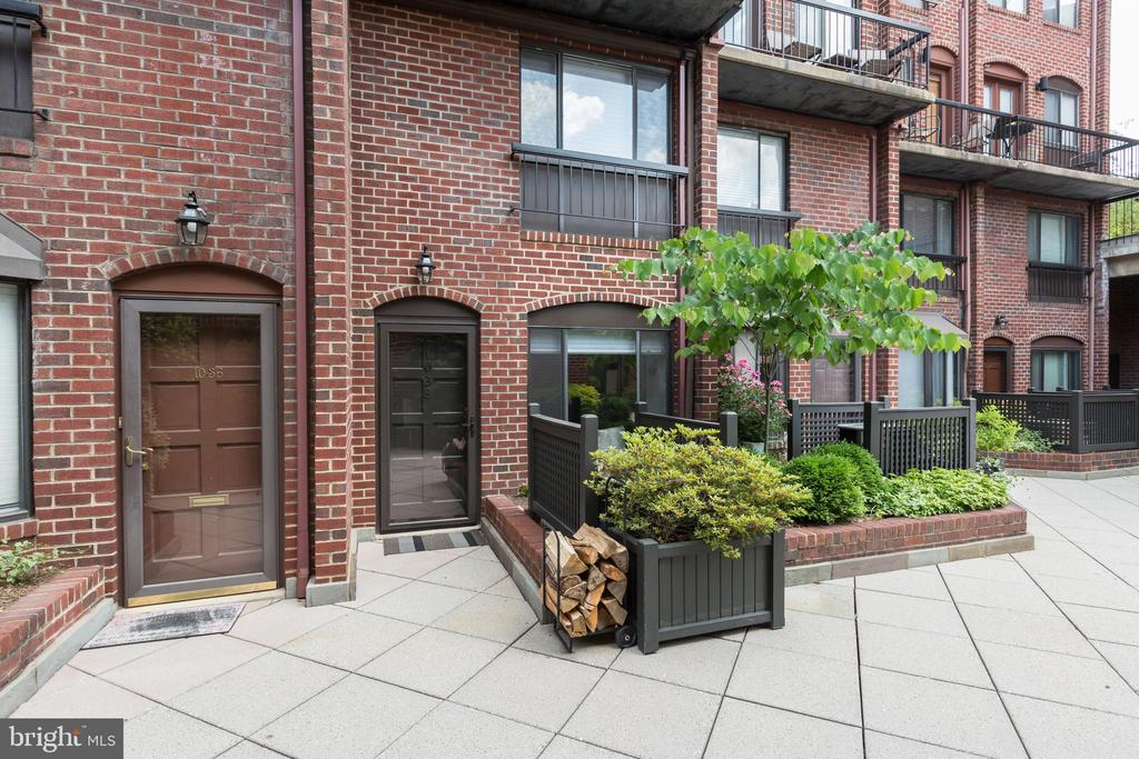 This extraordinary condominium at the Papermill offers a complete renovation with designer touches. The townhouse-style unit features hardwood floors, a sleek glass staircase, recessed lighting, a wood burning fireplace and exposed brick. Reserved garage parking and in-unit washer dryer convey. With an on-site pool and security guard, the Papermill is a pet-friendly association with low fees and no history of assessments. The location is second to none ~ nestled between M Street and the Georgetown Waterfront Park.