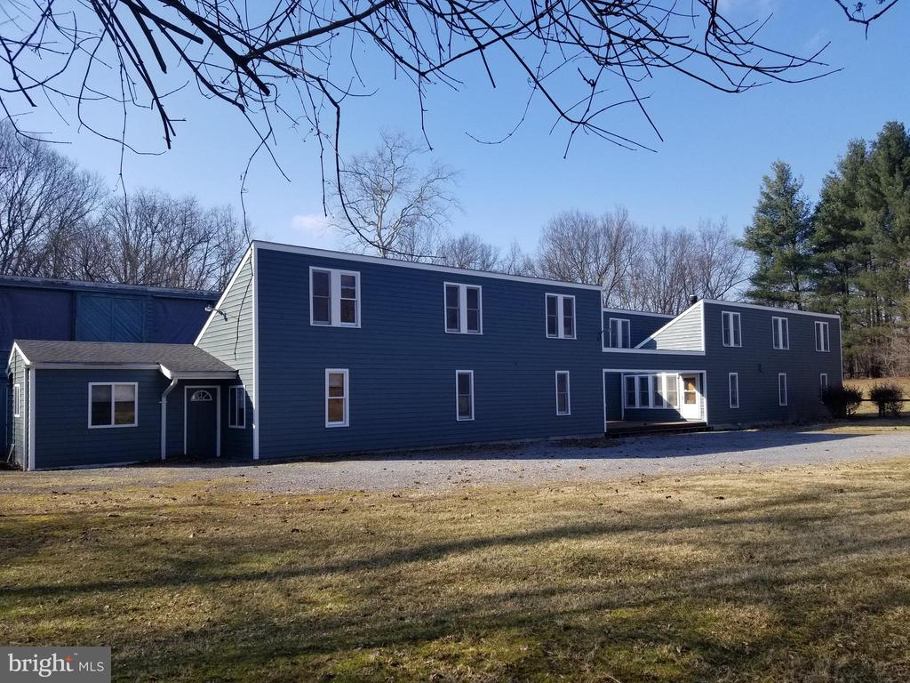 Spacious/Versatile, 2 x 6 Construction on 13.2, lovely very private acres minutes from Historic downtown. Total of 3330 sq. ft. finished and 1024 sq. ft. barn. Year round Rocky Marsh Run Stream on property. 658 sq. ft. separate Studio Apt. w/ Laundry Hook ups, full bath, loft bedroom, kitchen plumbed w/ 220 Electric. Horses allowed, acreage in Hay provides 1 - 2 cuts per season.