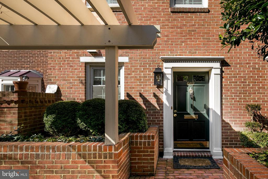 Convenience, charm and style! This stunning, must-see, townhouse-style condo, nestled in a quiet, quaint courtyard in Old Town Alexandria, offers the best of everything!   Whether relaxing or entertaining, you will appreciate the easy comfort of this open concept floorplan, with plenty of natural light, renovated kitchen, gorgeous family room with fireplace, and private stone patio. Two large bedrooms on the second floor, plus full, updated bathroom. Huge loft on the third floor, complete with bathroom, is perfect for a master bedroom en suite, a luxurious home office, a TV/play/family room, more! What works for you? Ample closet space. Freshly painted. Hardwoods. High-end finishes throughout. One assigned garage space conveys.  Move right in! Walkable to Old Town shops, restaurants, the Potomac, dog parks, the Bike Trail, Metro, much more! Easy commute by car or Metro to DC, Pentagon, Mark Center, everywhere you want to be!