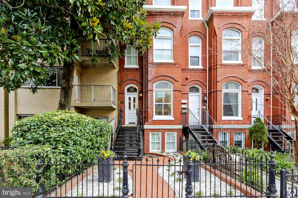 Memorial Day Sale! Rare opportunity to own a Dupont Circle address. This Historic Victorian has 4 levels. Built in 1870/1895 and remodeled in 2011 with 4 bedrooms and 3.5 baths. See floorplan tour. Great neighborhood! 98 Walk Score! Walk 2 blocks to Dupont Circle Metro, dining and entertainment. 2 blocks to Safeway & Whole Foods, 4 blocks to Trader Joe's. Near embassies and short walk to White House.Main level living room, half bath and modern kitchen with large hardwood deck. The next level has 2 bedrooms with a large bath. The top level contains the master suite with enormous bath and walk-in closet. The lower level has front and back entry, family room (or 4th bedroom), full bath, utility and laundry rooms. The stairwell skylight allows natural light into all levels. High ceilings, custom millwork, crown moulding, oak hardwood floors, solid wood doors & casings, crystal doorknobs, recessed lighting, gourmet eat-in kitchen w/pantry, Calacatta Gold marble baths, Subzero refrigerator and additional freezer drawers, Wolf gas range, Whitehaus sink, Hansgrohe faucet, Bosch dishwasher, KitchenAid microwave convection oven, potrack, Waterworks freestanding tub with Perrin & Rowe tub filler, Steamist shower, heated towel racks.