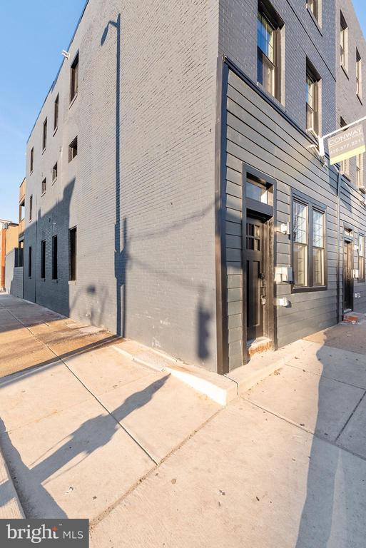 $10K PRICE REDUCTION!!! Eligibility for grants! Check out the virtual tour here: https://unbranded.youriguide.com/2100_e_fayette_st_baltimore_md. Sleek and modern finishes throughout this 3 bedroom, 3.5 bath full renovation. Tray ceilings, granite countertops, modern lighting and black stainless appliances complete the gourmet kitchen. Upper level has two bedrooms, each with their own bath. Plus second floor laundry and deck. Top floor, full house length master suite with walking closets. Enjoy coffee and gorgeous city views from your walk-out deck. Enclosed garage completes this incredible renovation. Motivated Seller!