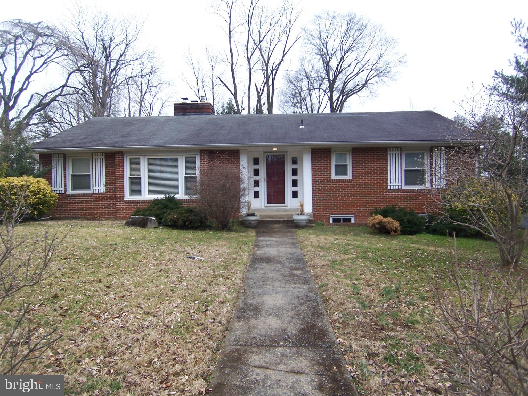 Classic large Rambler updated and remodeled with new kitchen 2019. Home boasts 3 large bedrooms, 3 baths, living room w/fireplace, Sun porch addition, and all hardwood floors upstairs. roomy 2 car attached garage. Stone patio in rear. Finished basement with wet bar, built-ins, recess/indirect lighting, full bath and mud room at rear entrance. Huge laundry big enough for an exercise room with spare fridge, plus storage room. Efficient new 2018 furnace w/Nest. Great easy-access neighborhood yet very private.