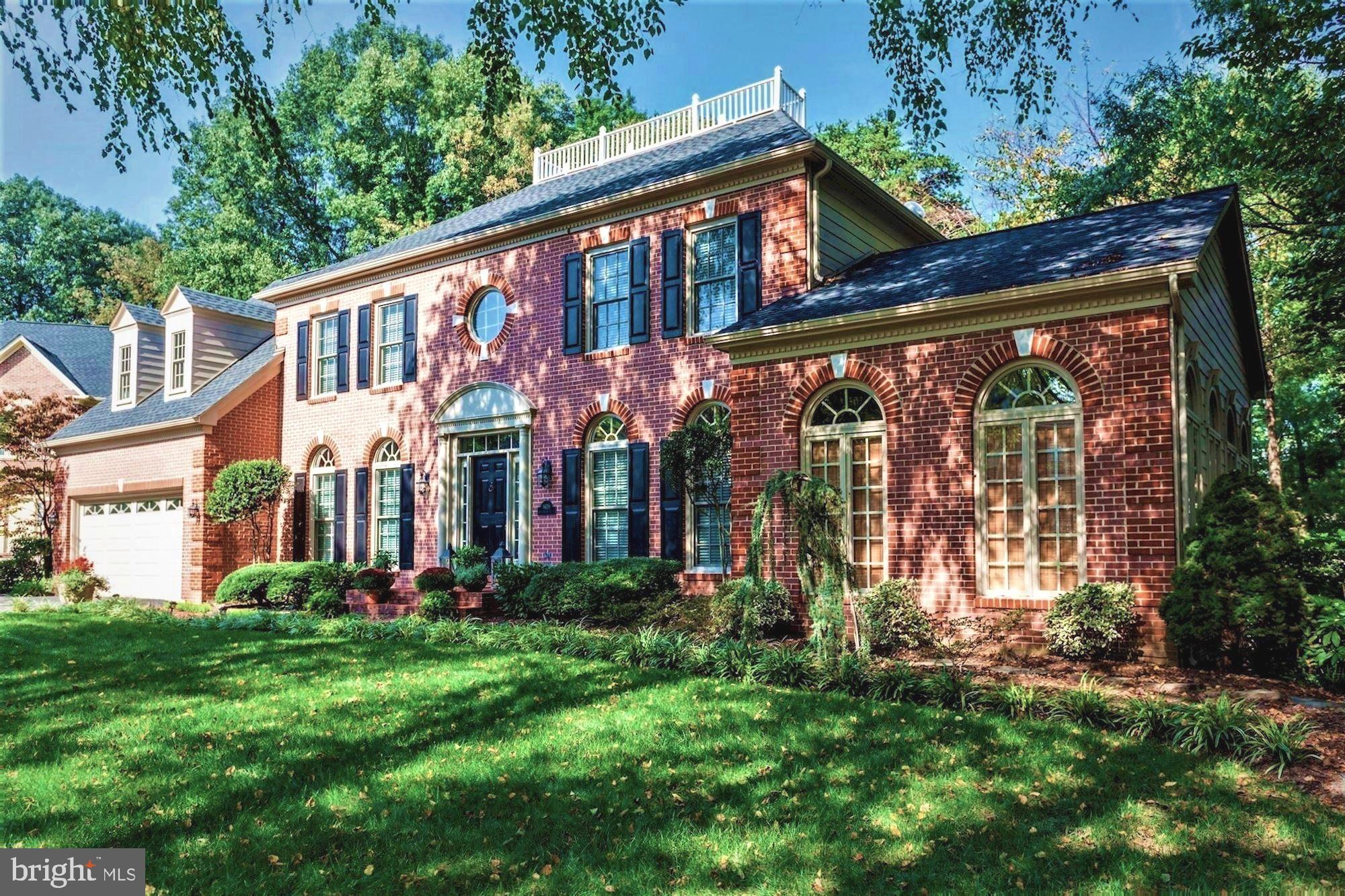 Elegant Georgian Colonial embraces charm & beauty in the sought-after community of Crosspointe. This stunning home features a spectacular sunroom accented by Palladian windows with French doors opening to a brick patio and a tranquil setting. The family room is truly the heart of the home, featuring an inviting fireplace framed by soaring 2-story windows with a sweeping view of the backyard. The adjoining eat-in kitchen features granite counter tops, stainless steel appliances, a new double oven, and a gas cooktop w/ telescopic downdraft. French doors lead to the home office with handsome cabinetry. Both the formal dining and living room are appointed with Palladian windows. The upper level boasts an impressive spa-inspired master bath, featuring an oversized soaking tub, luxurious shower with natural stone marble and heated floors. The master bedroom has a cathedral ceiling and lovely new oak hand-scrapped hardwood floors. A mirror pocket door opens to the walk-in wardrobe with coffee station & mini refrigerator. The dressing area is appointed with a set of 3 architectural mirror doors, each faceted with crystal knobs. The remodeled hall bath has a jetted tub, cantilever double vanity, solid cherry cabinets and is cleverly designed with a separate water closet and washbowl, providing private bedroom access. The lower level is perfect for entertaining. Enjoy movies with surround sound, serve refreshments at the wet bar, and play a game of pool with table that conveys. The finished lower level provides a comfortable space for an au pair and out of town guests, offering an updated full bath, 5th bedroom, an additional bonus room, a play room/exercise room, plus ample storage. The exterior features architectural roofing shingles and HardiPlank siding. Sited on 0.48 acres, the property is professionally landscaped w/ natural fieldstone retaining rock walls and stone steppers. The grounds have an irrigation system and are landscaped w/ drainage and erosion control. The mature trees provide a lovely backdrop with a private setting to relax on the Trex deck or the flagstone patio. A meandering path leads to the garden shed, custom painted to harmoniously blend. Home is equipped with a security system and a 20kW back-up generator. Amenities of Crosspointe include two swimming pools, tennis courts, soccer field, walking trials, and two scenic ponds. Residents have convenient access to I95, the Fairfax County Pkwy, and to VRE, offering a rail transit alternative.