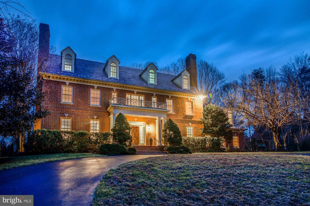 First time on the market! Stunning two acre estate nestled at the end of a cul-de-sac in Chamborley just 1 mile before Great Falls Village off Georgetown Pike.  With over 8,000 SF, this stately brick colonial offers a grand foyer, formal living and dining rooms, a gourmet open kitchen surrounded by windows, a main level library, a generous screened-in porch, fully finished walk out basement, and a three car side-load garage. Distinctive touches can be found throughout four gorgeous finished levels, including hardwood floors, ten ft ceilings, built-ins, four fireplaces, and mouldings. Master BR includes a sitting room w/ a cedar closet in addition to his and her walk-in closets, and a spa-like ensuite bath. This beautiful home is immediately ready for you to enjoy with new carpet, fresh paint, and updated light fixtures throughout. The stunning lot located next to a horse farm is surrounded by trees and offers a prime setting for luxurious entertaining, both indoors and out. Close-in location offers excellent access to I-495 and other major commuter routes. Langley Pyramid!