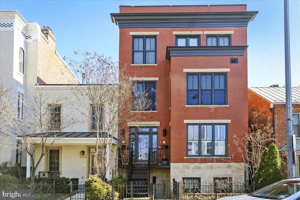 Incredible NEW LISTING!! Historic DC charm meets modern design. This sun-filled 3BR/3.5BA home has 12ft ceilings with floor to ceiling windows throughout; you'll enjoy natural light all day long!  The width and length of the unit, with its open floor plan is perfect for entertaining or quiet nights in by the fire. The gourmet kitchen is filled with sunlight and space to spread out. Off the table spaced kitchen is the family room with a bank of floor to ceiling windows and french doors that lead to your large balcony. On the second level, you will enjoy a  Master suite and large en-suite bath with gas fireplaces, large private balcony, custom shutters, and skylights!  Other amenities include washer/dryer on the bedroom level, hardwood floors through out, wine refrigerator, and intercom system, plus 2 parking spaces!. Just a block from the Metro, shops, and restaurants. Ideally located at the convergence of the Logan/Shaw/U St neighborhoods.