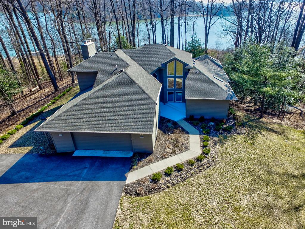 """BOATER'S PARADISE !!  Large waterfront home on over 2 acres on the Magothy River.  FOURTEEN FOOT water depth at end of pier. Commercial grade pier with two slips and lifts - One will hold 60 ft at 80,000 lb / the other 40 ft at 60,000 lbs.  Surrounded by agricultural and preserved properties.  VERY PRIVATE.  With over 5000 sq ft on three levels - this home has a fantastic wide open floorplan designed to take advantage of the spectacular water views from nearly every room. Tremendously solid construction.  This is the perfect waterfront for anyone who enjoys boating or simply enjoying the relaxed waterfront lifestyle. Covered screened Porch/Meditation/Yoga Room off master bedroom .. enormous Master Bath with separate shower and soaking tub. Possible 5th bedroom.  Numerous decks and plentiful built-ins throughout.  Move in ready - or add your own personal touches. Two car garage parking, storage shed, """"dog house"""", and Screened gazebo and sun deck located on the pier.  This is what waterfront living is supposed to look like."""