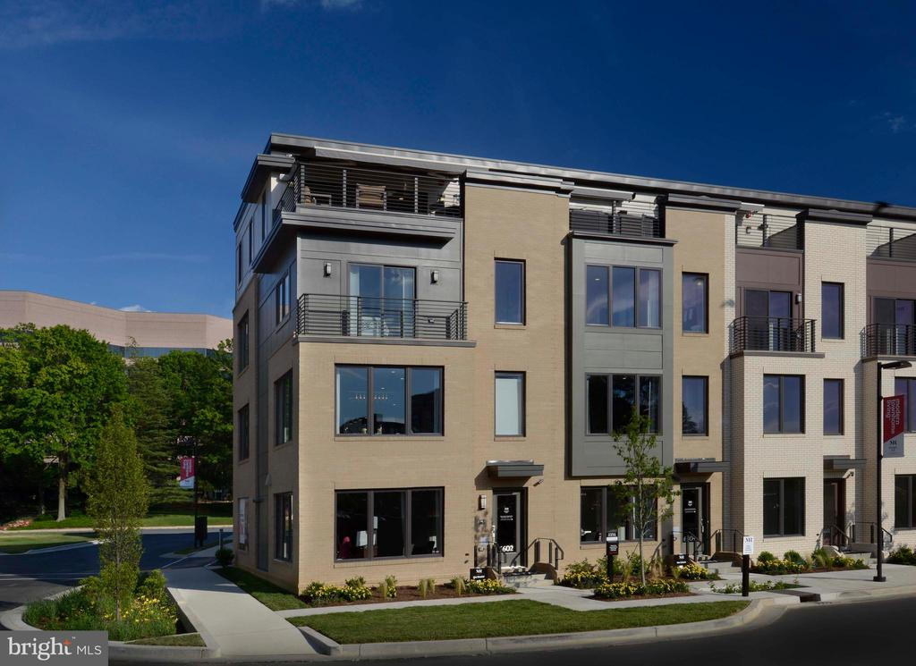 Incredible close out savings at Montgomery Row.  End unit Daniel - former model townhome for sale.  Tons of upgrades, rooftop terrace, 2-car garage parking, loft level, rear deck.  Steps to Montgomery Mall and Wildwood Shopping Center.