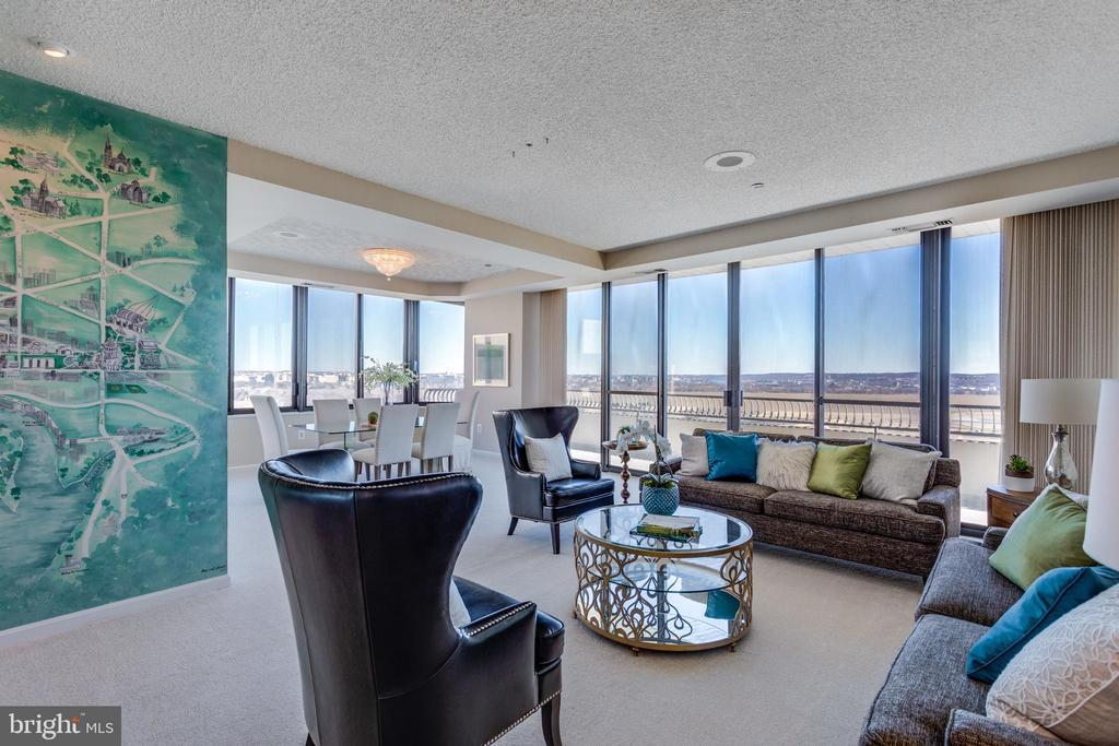 Once in a lifetime opportunity to live in the exquisite, one of a kind end-unit Penthouse in Crystal Gateway Condominiums with spectacular panoramic views of the Potomac River, Monuments, Reagan National Airport and so much more! Nearly 2,900 sqft of luxury high rise condo living on 2 levels. Big, bright open concept living room features custom wall art and a wet bar. The 250 sqft expansive private terrace is where you want to be to enjoy the breathtaking views and fireworks during the 4th of July. Main level bedroom with full bath/powder room. 2 additional bedrooms on the upper level plus den/library/study, all with huge windows, making it easier for you to enjoy the sweeping views and natural light. The master suite is simply stunning with its sitting room, huge full bath, walk-in closet and additional closet space. The upper level study/library/den offers built-ins and a fireplace, and could be converted to a 4th bedroom. Luxurious building amenities include concierge, outdoor pool, indoor pool, community room, exercise room, sauna, meeting room and much more. Minutes to the White House, Pentagon and National Airport. Walk to Amazon~s upcoming East Coast Headquarters, Crystal City shops, restaurants, offices, and covered walkable underground access to Crystal City Metro on the Blue and Yellow Line. This Penthouse will truly take your breath away. Crystal City is without a doubt one of the hottest submarkets in the DC metro area. Embrace life at the top!