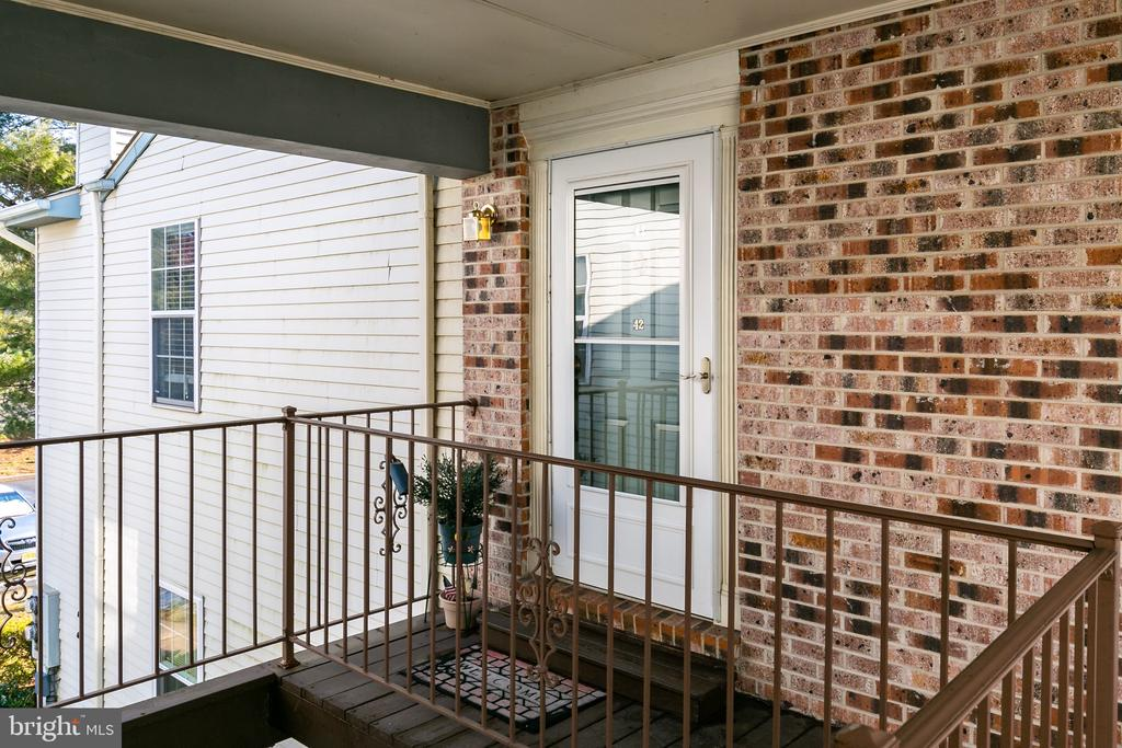 This wonderful upper unit in Holiday Village has all the updates in the systems. Newer heater, air conditioner, and hot water.  The bath has been updated and newer flooring in the kitchen, with fresh paint.  All neutral carpet throughout the living space.  Enjoy the pool, gym, and activities that Holiday Village has to offer. Close to shopping, dining and easy access to major highways.