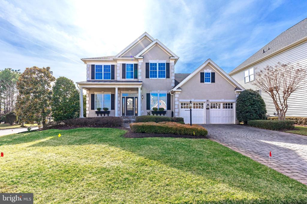 ** Opportunity ** Bring All Offers ** 3,200+ sqft 4 Bed /3 Bath house at the Regency at Dominion Valley, a 55+ gated Golf community. Property includes Two-car garage & Paver driveway and Backs to Landscaped trees & Golf course. New roof. Lots of upgrades throughout ~ Coffered & Recessed ceilings, Built-ins, Plantation shutters & custom trim work. Loft overlooks Open Family Room layout w/ Double-height ceilings & New floors. Main level Master w/ private En-suite Bath & walk-in closet. Large unfinished basement (2,298 sqft) w/ walkout. Rear flagstone patio.