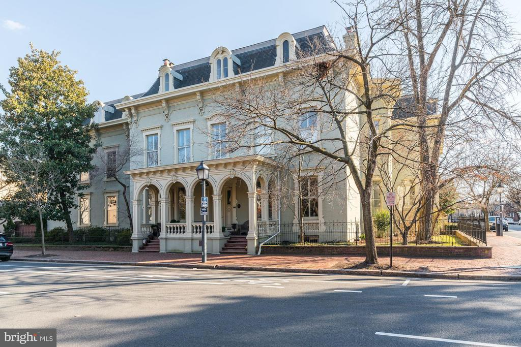 Gracious and elegant Victorian home in the beautifully restored and historic Swann-Daingerfield building in the heart of Old Town, Alexandria.  This exclusive and beautifully restored building contains just 12 units, each with its own private entrance.  At just a block to Washington Street and King Street, this is the best building and location in all of Old Town!  It is just a short stroll to the restaurants, unique shops, and farmers market on King Street, as well as the Potomac River, which is just 7 blocks away.  It is a comfortable 14-minute walk to the King Street metro station and a seven minute drive to Washington, DC.   Once inside, this two bedroom, one and one/half bath condo features soaring 11~ 6~ high ceilings, gleaming hardwood floors, a wood burning fireplace, an elevator, a bright and spacious eat-in kitchen with Corian counters, and separate dining space which leads to the private balcony overlooking tranquil gardens & courtyard.  Other amenities include convenient assigned parking (#10) and an extra-large secure storage unit in the basement next door.  Additionally, pets are allowed!706 Prince Street -  The History of Swann-Daingerfield HouseThe Swann~Daingerfield House was built in 1802 by Thomas Swann, a prominent area attorney.  In 1832 the property was sold to Henry Daingerfield, a successful importer and shipper.  In 1899 the property was the sold to Saint Mary~s Academy for $10,500, and served as a boarding school for over a century.  In the 1940s it was sold to the Alexandria Hospital for $100,000 and was used as student housing for the hospitals School of Nursing.   It was then converted into condominiums in the 1970s and has been a private residence for nearly 50 years.  Open House 3/17/19 from 1:00 to 4:00.