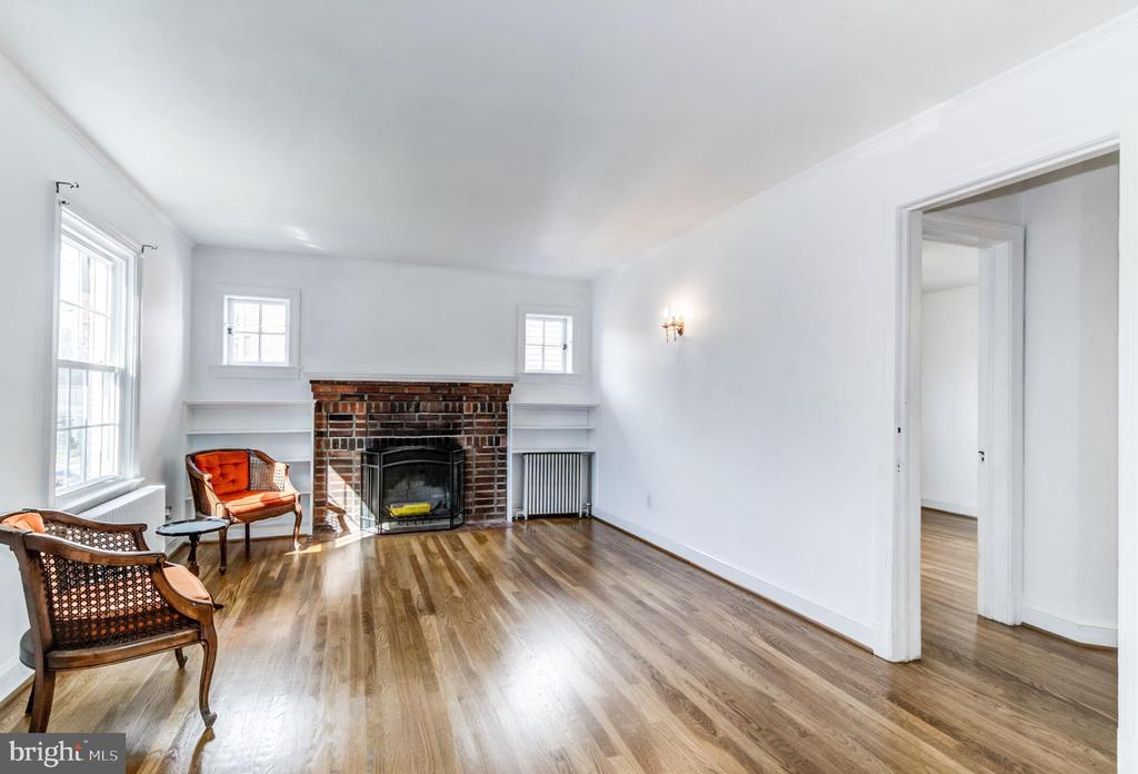 * Offers due Wednesday March 13th 1:00 pm * NEW LISTING - FIRST OPEN HOUSE SUNDAY MARCH 10th 1:00-3:00pm. Rarely Available - Cozy Cape Cod steps from METRO and Ballston development. **Exceptional Walkability** Just two blocks to the heart of Ballston! Bright 1930s Cape Cod with charming original detail - crystal door knobs, built in's, gorgeous pine flooring. Wood Fireplace. Master suite w/ top floor balcony! Newer windows, boiler and refinished hardwoods. Replaced water heater. Fully fenced yard w/shed. Endless possibility - No HOA fees!~As-Is.~