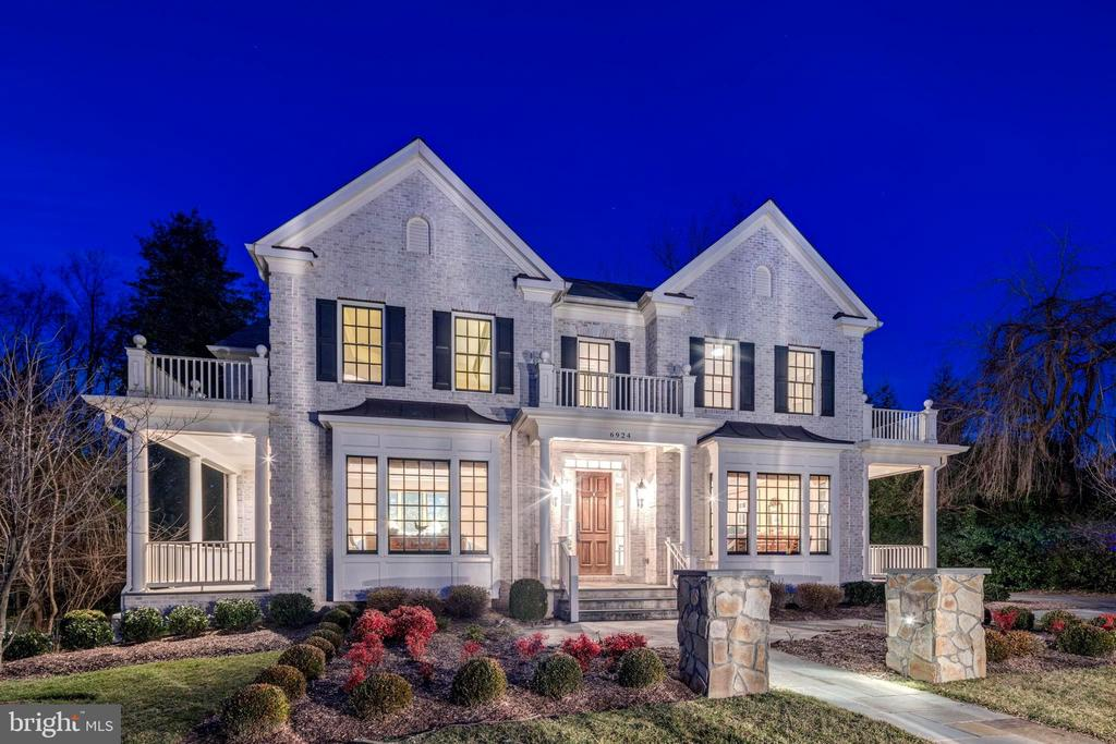 This Custom all brick and stone colonial is located in Langley Forest,  one of McLean's most sought after neighborhoods.  Special features include 7500+ sf of living space, 10' ceilings on the Main level, 3 Fireplaces, Whole House Generator, a 3-car garage with a Finished Suite above, Walkout Lower Level with Recreation Room, Au Pair suite, Wet Bar and Media Room. The Dramatic Gallery Foyer is flanked by the Living and Dining rooms with arched entrances and French doors to Cozy Porches. The Study with Built-Ins is privately located off the foyer.  The expansive Family room has walls of windows, a gas stone fireplace and coffered ceilings. The gourmet kitchen features Jenn-Air appliances and a large center island and adjoining breakfast room. The butlers pantry includes a wine rack and refreshment refrigerator.  Hardwood floors gleam throughout the main level and the upper level hallway and Master.  The Master Suite includes a sitting room with gas fireplace and luxurious bathroom.  There are three additional bedrooms with private baths.  Ideally located just minutes to 495,  Tysons and Washington DC. Convenient to Reagan and Dulles International Airports.